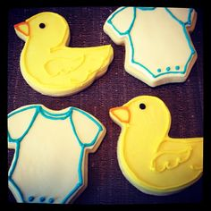Duckie and Onsie cookies for Meghan's baby shower.  Sugar cookies with fondant and piped decorations