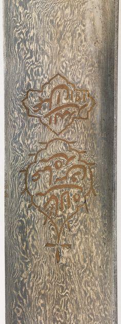 Persian shamshir / saif, 17th century, detail view of the damascus/watered steel blade,, L. 39 1/4 in. (99.695 cm), Met Museum.