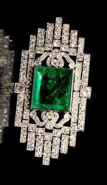 An Art Deco emerald and diamond brooch, circa 1925.