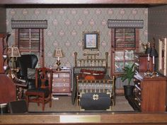 """The man who is lucky enough to live in this room is preparing to take a trip.  Notice leather suitcase and travel kit on bed.  Furniture made  from House of Miniature kits plus bedding, cornice boards and blinds are hand made.  Parquet hardwood floor.  Brass bed hand crafted by Clare-Bell Brass.  This room contains many interesting men's accessories.  Cherry box.  Overall dimensions: 15""""W x 14""""D x 10""""H."""