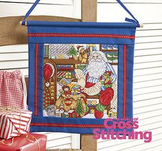 Father Christmas' office - naughty or nice? Cross stitch chart by The World of Cross Stitching, issue 197