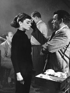 """dearfawndoe: """" Audrey Hepburn gets her makeup touched up on the set of Funny Face. """""""