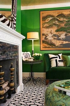 Green living room with art. #Emerald #Decor #Style