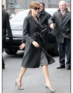 Angelina Jolie - Less pretty, more practical, but not at the price of Sophistication (Head-to-toe gray Ferragamo ensemble is the epitome of Simplistic Chic).