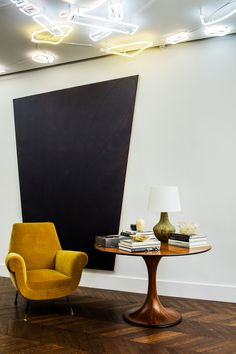 Luis Laplace and Christophe Comoy use a mix of French tradition, light, colour and bespoke furniture to perfect an art collector's main residence in Paris.