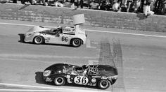 Jim Hall and Dan Gurney's Lola T70 Mk.3 roll forward as the grid forms up for the 1967 Riverside Can-Am. At the start Gurney would get by everyone to take the lead. Three laps later, his engine blew up. Hall would battle back and forth with Bruce McLaren, with the latter winning by 2 seconds, having deliberately over-revved his engine to remain ahead of the speedy Chaparral. Al Bochroch photo.