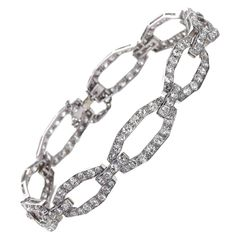 View this item and discover similar for sale at - A fine Art Deco Boucheron diamond link bracelet, mounted in platinum, set with approximately of diamonds. Diamond Bracelets, Link Bracelets, Diamond Jewelry, Bangle Bracelets, Art Deco Jewelry, Fine Jewelry, Jewellery, Boucheron Jewelry, Art Deco Diamond