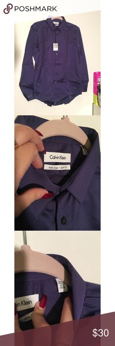 Calvin Klein Steel Dress Shirt Men's CK purple steel dress shirt. The size says 15 and 1/2 , 32/33. Brand new with tags. Wrinkled because of storage. The last photo shows the steel look of it. It's gorgeous. Calvin Klein Shirts Dress Shirts