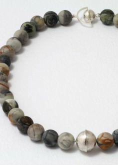 """etched silver bead and matching """"bead"""" clasp, strung on matt picasso jasper"""
