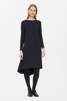 This A-line dress is made from a soft stretchy front panel and sleeves with a cotton-wool blend back panel. Oversized, and flaring out towards the hemline creating a voluminous effect, it has a graduated hemline, 7/8 sleeves and a round neckline.