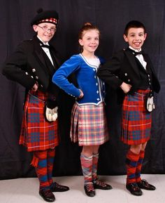 Left and right - male dancers in kilts #hamilton #red #tartan