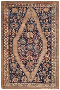 Serab Camelhair, 9ft 5in x 14ft 7in, Circa 1900.  A rare level of artistic innovation for a room size antique Persian rug combines with consummate craftsmanship to create the great impact of this one-in-the-world Serab Camelhair antique carpet. Lustrous undyed camelhair imparts great resonance to the lively array of blossoms that fill its deep, naturally dyed, asymmetrical indigo field, creating an entirely singular composition.