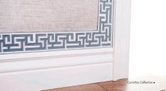 Samuel and Sons Passementerie..I love the way the fabric tape was used to edge the wallpaper.