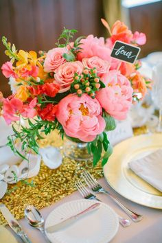 Beautiful pink wedding reception centerpiece  and gold sequin table runner.