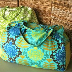 Make Your Getaway Duffle Bag Sewing Pattern - Basic duffle, other post showed good bag shape and side handle placement that looked more practical