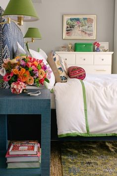 navy headboard and side table + green accents + gray walls