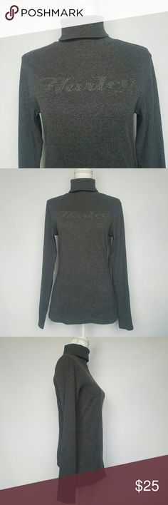 """Harley Davidson turtleneck t-shirt -Make an offer! Harley Davidson Gray Turtleneck long sleeve t-shirt, stretchy material. Great condition!   Bust 35"""" (All-around) Waist 30"""" (All-around) From shoulder to bottom 25.5"""" Shoulder to shoulder 16"""" Sleeve Length 25""""  🔔Feel free to make an offer on a single item or bundle! 📦I ship same or next day! 🚭From a smoke free home. Harley-Davidson Tops Tees - Long Sleeve"""