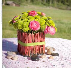 bright green button mums and raspberry-colored ranunculuses