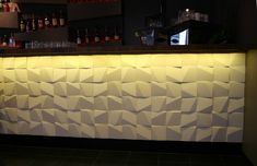 Relief is a wall tile designed by the architect Eva Kai-Larsen. It is made of a very special concrete material, called Soft Concrete. The tile has a square shape with one or two corners cut, so that sloping planes are formed.