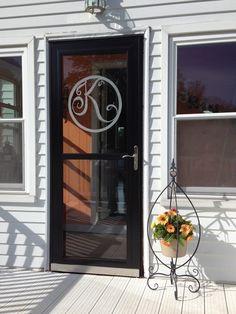 Monogrammed letter glass etched door
