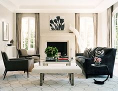 Monique Lhuiller gray velvet sofa and chairs, white modern white tufted bench, madeline weinrib rug, white garden stool, fireplace, gray silk drapes, art, zebra pillows, acrylic console table and coffered ceiling.