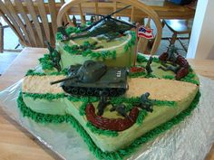 Army Cake Army theme cake for a 7 yr old who loves anything Army. Chocolate cake, buttercream frosting. Toys used for decorations, so he...