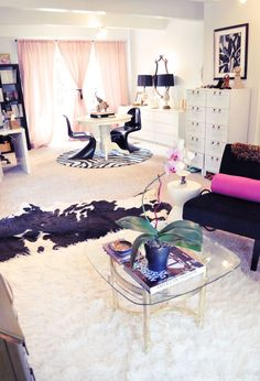 black and white and pink and gold home office and sitting area