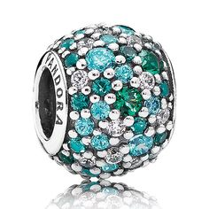 Get into the summer mood by adding this sparkling pave charm with multiple hues of oceanic green to your tropical bracelet design. Made of sterling silver and encrusted with 78 glimmering hand-set cubic zirconias in shades of green, it will bring any ocean-themed bracelet to life.