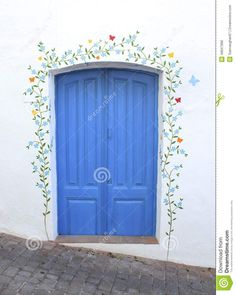 blue-door-flower-mural-white-washed-wall-pretty-stem-flowers-has-been-painted-around-whitewashed-spanish-49947996.jpg (1039×1300)