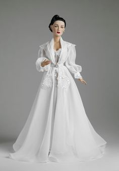 """The Angel's Deception - OUTFIT ONLY LE500 $114.99 Fits 16"""" Tyler BW Body w/ High-Heeled Feet Even the most conniving vixen can have the aura of an angel, swathed in a luxuriant chiffon nightgown, trimmed with sequined lace around the waist and bust, under a matching chiffon robe with sequined epaulets and cuffs. A slim charmeuse belt with a rhinestone buckle ties it all together. Rhinestone stud earrings and molded plastic shoes also included."""