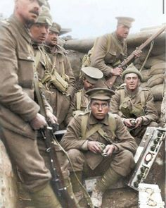WW1. Scottish soldiers from the 1st Battalion Scots Guards during the battle of Loos, September 1915. The men are showing off their mill bombs whilst taking cover in the front lines. The 1st Battalion Scots Guards suffered heavy casualties during the battle of Loos. They would attempt to take the German held position known as Hill 70. During the charge, the Scots were caught in a German artillery bombardment, resulting in heavy casualties once again. By Dylan Millard.
