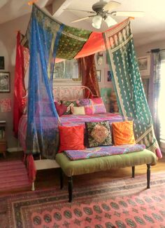 Hand sewn Gypsy Bed Canopies! Vintage sari's lend themselves perfectly to this use with their vivid jewel tones, glittering embellishments and whispy yet decadent materials. Via Gypsy Yaya. Curtains by Babylon Sisters Gypsy Curtains.