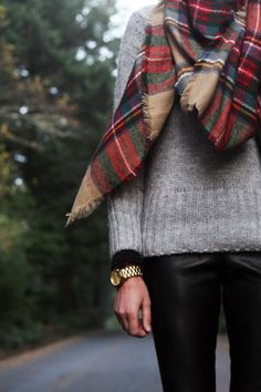 tartan scarf, gray sweater, black pants and gold watch