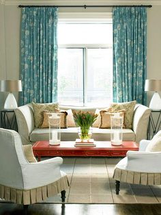 Creative touches give this living room fresh style. Tailored slipcovers create a crisp backdrop for an old table repainted to draw attention. Even the simple task of flipping the rug to expose a subdued, textural base adds interest.