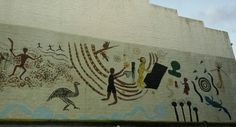 Indigineous themed wall art on the corner of Campbell Lane and Cowper Street, Glebe.