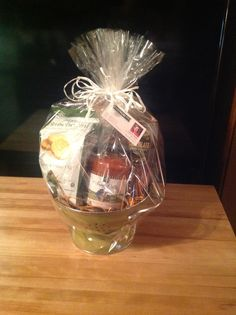 Client Gift Butternut Squash Pasta Sauce, Rosemary & Olive Oil Bruschettini, Organic Italian Pasta, and Chocolate Rolled Wafers all set in a green metal Colander