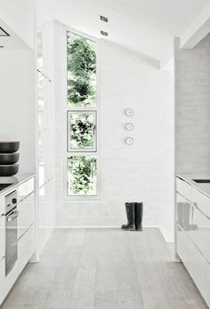 Kitchen | Love the floor, the windows, the natural light | The Fredensborg House by NORM Architects