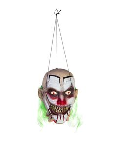 Hanging Clown Head exclusively at Spirit Halloween - Freak out your guests with this Hanging Clown Head. No one will be laughing when they catch a glimpse of this ghoulish rotten teethed, blood drooling clown with crazy blood red eyes!