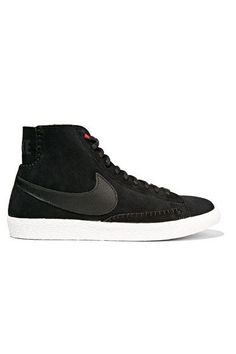 Nike's 'Blazer Mid' sneakers are an update to the brand's classic basketball shoe from the '70s. Lightweight and flexible, this black suede pair is finished with a red shearling lining for a pop of color and warmth. The rubber sole provides traction and durability.