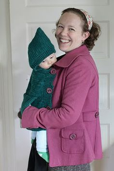 Babywearing Hooded Coat Extension Panel. it also has a little muff for mommy's hands!