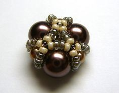 Beaded bead with excellent photo tutorial.  Треугольная плетеная бусина   biser.info - всё о бисере и бисерном творчестве