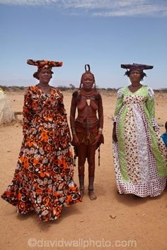 Africa | Two Herero women standing with a Himba woman in the middle.  Near Uis, Namibia | ©David Wall