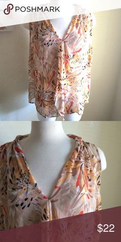 Lane Bryant tank Pretty tank! It's a tan color with red and yellow patterns on it. V neckline. Lightweight and flowy. Semi sheer. The tag was cut out but it's an 18/20. Lane Bryant Tops Tank Tops