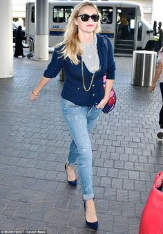 Quick trip: Reese jetted out of Los Angeles just four days before she was seen returning...