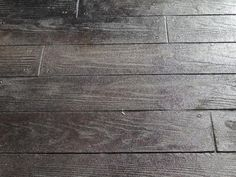 This is an outdoor concrete treatment, walnut stain, to look like wood floor-boards. Me likey.
