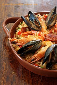 """""""Paella"""" is currently an internationally-known rice dish from Spain. Today paella is made in every region of Spain, using just about any kind of ingredient that goes well with rice. Fish Recipes, Seafood Recipes, Great Recipes, Cooking Recipes, Favorite Recipes, Seafood Paella, Seafood Dishes, Paella Food, Seafood Soup"""