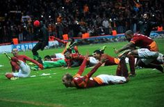 Galatasaray's players celebrate winning their Champions League Group B match on Dec 11. REUTERS photo