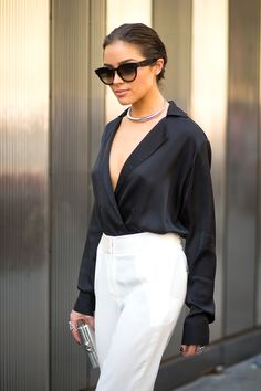 Olivia Culpo - Black blouse and white trousers