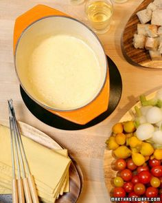 ''Classic Cheese Fondue'' Gruyere and Emmental cheeses create the base of this classic fondue. A touch of cayenne pepper and lemon juice add balance to the rich mixture.