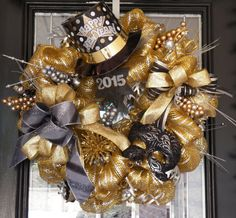 Pre-Order for 2016! New Years Wreath, New Years Party Decoration, Christmas Gift, Fast Shipping  This New Years wreath is made with layered loops of a metallic gold with silver stripes deco mesh and accented with black and silver bows, glittered gold and silver decorative ornaments, mask, star with 2016, and a Happy New Year Hat. This wreath measures approx. 29.  New Years Wreaths will begin shipping Mid to late November.. Orders will ship in the order they are received.  To see all of my…